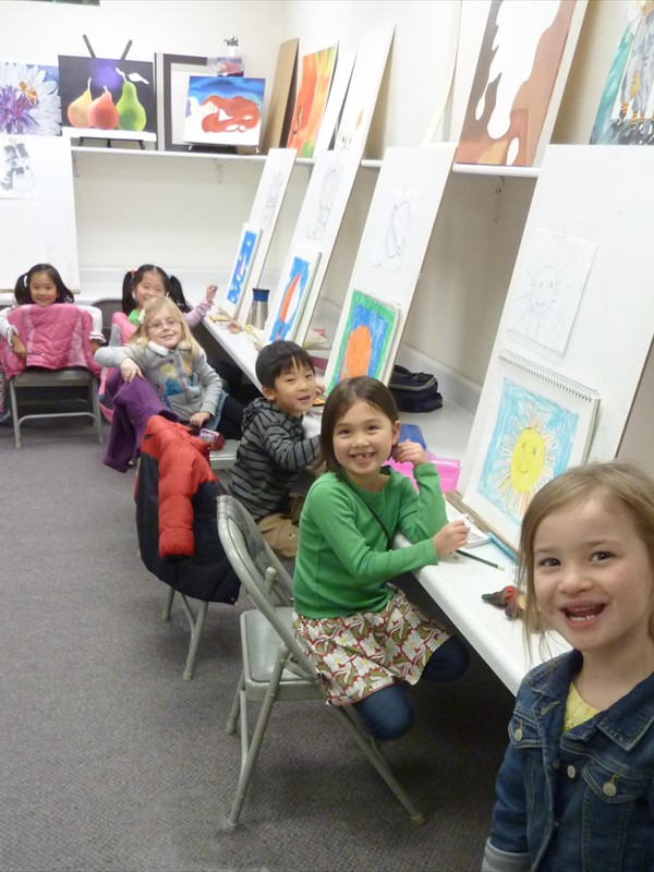 FIVE-YEAR-OLD STUDENTS HAVING FUN IN CLASS